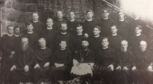 The Monks of Saint Bernard Abbey on the election of Abbot Bernard Menges, OSB, in 1904 From left to right, front row: Fr. Gammelbert Bruner (1850-1909), Fr. Fridolin Meyer (1854-1936), Abbot Elect Bernard Menges (1866-1933), Abbot President Peter Engel (1856-1951), Fr. Boniface Seng (1867-1957), Fr. Severin Laufenberg (1847-1929), Fr. Dennis Stoltz (1845-1912); Middle Row: Fr. Alphonse Klug (1875-1964), Fr. Aegidius Schulkers, Fr. Benedict Oberdoerfer (1874-1951), Fr. Ignatius Mayer (1874-1951), Fr. Ambrose Reger (1872-1938), Fr. Theodosius Osterrieder (1867-1961), Fr. Osmund Wiesneth (1874-1951), Fr. Paul Meyer (1868-1916), Fr. Gregory Sturm (1878-1955); Back Row: Fr. Robert Reitmeier (1874-1956), Fr. Vincent Haegele (1874-1935), Deacon Ferdinand Schorer (1877-1922), Fr. Placidus Becker (1873-1948), Fr. Raphael Obermaier, Fr. Edmund Ferstl (1878-1956), Fr. Augustine Palm (1875-1961)